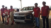 """PT Mitsubishi Motors Krama Yudha Sales Indonesia (MMKSI) menggelar acara bertajuk """"Engineered Beyond Tough Experience"""" di Sirkuit off-road Pagedangan, BSD, Tangerang, Kamis (15/8/2019). (Septian / Liputan6.com)"""