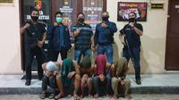 Foto para pelaku pencabulan usai ditangkap polisi (Liputan6.com/Fauzan)