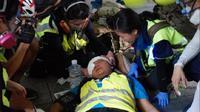 Jurnalis asal Indonesia Veby Mega Indah tertembak peluru karet saat meliput unjuk rasa di Hong Kong pada Minggu 29 September. (Twitter/@yukisuet1)
