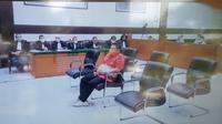 Terdakwa Dirut RS Ummi Andi Tatat menjalani sidang tuntutan, Kamis (3/6/2021).(Merdeka.com/Bachtiarudin Alam)
