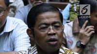 Mantan Sekjen Partai Golkar, Idrus Marham jelang menjalani sidang pembacaan dakwaan di Pengadilan Tipikor, Jakarta, Selasa (15/1). Idrus didakwa terkait dugaan suap kerja sama pembangunan PLTU Riau-1. (Liputan6com/Helmi Fithriansyah)