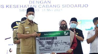 Pemkab Sidoarjo menggratiskan angsuran BPJS Kesehatan kelas 3 warganya. (Dian Kurniawan/Liputan6.com)
