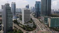 Pemandangan gedung bertingkat di kawasan Bundaran HI, Jakarta, Kamis (14/3). Bank Indonesia (BI) optimistis ekonomi Indonesia akan lebih baik di tahun 2019. (Liputan6.com/Angga Yuniar)