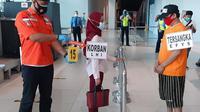 Rekonstruksi kasus pelecehan seksual, pemerasan dan penipuan, di Terminal 3 Bandara Soekarno Hatta, Rabu (30/9/2020). (Liputan6.com/Pramita Tristiawati)