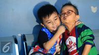 Daus Mini bersama putranya, Ivander Haykal Firdaus. (Herman Zakharia/Liputan6.com)
