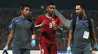Striker Timnas Indonesia U-19, Rafli Mursalim, hanya mengalami kram saat mengalahkan Singapura dalam laga lanjutan Piala AFF U-19 2018 di Stadion Gelora Delta Sidoarjo, Selasa (3/7/2018). (Bola.com/Aditya Wany)