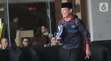 Ekspresi anggota Badan Pemeriksa Keuangan Rizal Djalil usai menjalani pemeriksaan di Gedung KPK, Jakarta, Rabu (9/10/2019). Rizal diperiksa sebagai tersangka terkait kasus dugaan suap proyek pembangunan Sistem Penyediaan Air Minum (SPAM) di Kementerian PUPR. (merdeka.com/Dwi Narwoko)