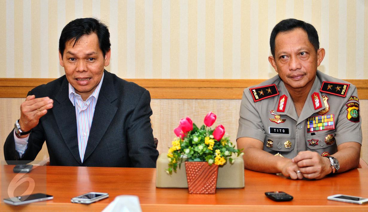 Kapolda Metro Jaya Irjen Tito Karnavian dan Wakil Sekjen MUI Amirsyah Tambunan melakukan pertemuan di Polda Metro Jaya, Jakarta, Selasa (7/7/2015). Pertemuan itu membahas Sahur On The Road (SOTR) yang akhir-akhir ini meresahkan (Liputan6.com/Yoppy Renato)