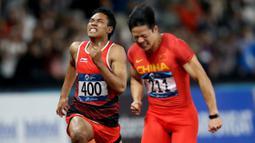 Pelari Indonesia, Lalu Muhammad Zohri, saat berlaga pada nomor 100 meter Asian Games di SUGBK, Jakarta, Minggu (26/8/2018). Lalu Zohri finish diurutan ke tujuh dengan catatan waktu 10,20 detik. (Bola.com/Peksi Cahyo)