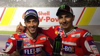 Pebalap Ducati, Andrea Dovizioso (kiri), membantah minta bantuan rekan setimnya Jorge Lorenzo untuk memenangi balapan MotoGP Malaysia di Sirkuit Sepang, Minggu (29/10/2017). (Ducati Motor)