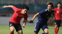 Duel Korsel vs Jepang di partai final sepak bola Asian Games 2018 di Stadion Pakansari, Cibinong, Sabtu (1/9/2018). (Bola.com/Dok. INASGOC)