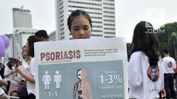 Mahasiswa dari Fakultas Kedokteran Universitas Indonesia (FKUI) menggelar kampanye tentang penyakit Psoriasis saat car free day di Jakarta, Minggu (4/11). Kampanye dilakukan dalam rangka memperingati World Psoriasis Day 2018 (Merdeka.com/Iqbal S. Nugroho)