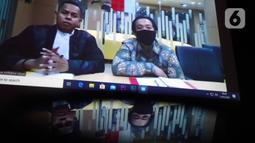 Terdakwa kasus dugaan suap dana hibah KONI, Miftahul Ulum menjalani sidang vonis secara online di Gedung KPK, Jakarta, Senin (15/6/2020). Asisten mantan Menpora, Imam Nahrawi itu divonis hukuman pejara selama 4 tahun ditambah denda Rp 200 juta subsider 3 bulan kurungan. (merdeka.com/Dwi Narwoko)