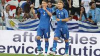 Dua striker Timnas Italia, Andrea Belotti dan Ciro Immobile. (VALERY HACHE / AFP)