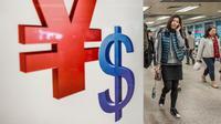 Seorang wanita melewati simbol yuan Cina dan dolar AS di Hong Kong. Foto diambil pada 28 November 2012. Langkah Bank Sentral China pada 11 Agustus 2015 menurunkan nilai tukar yuan terhadap dolar AS langsung membuat pelaku pasar ketakutan. (AFP PHOTO)
