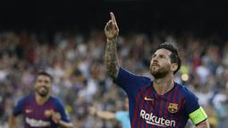 1. Lionel Messi (Barcelona) - 9 gol dan 5 assist (AFP/Josep Lago)
