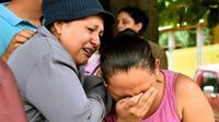 Keluarga korban kerusuhan penjara di Honduras. Dok: AFP