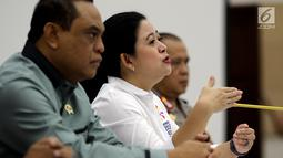 Menko PMK Puan Maharani memberi keterangan pasca penyelenggaraan Asian Games 2018 di kantor Kemenko PMK, Jakarta, Senin (3/9). Pemerintah sangat puas melihat venue pertandingan olahraga Asian Games 2018 selalu dipenuhi penonton. (Liputan6.com/Johan Tallo)