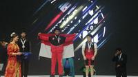 Mohammad Yasin di podium tertinggi Kejuaraan Angkat Besi Junior Asia 2020 (Istimewa)