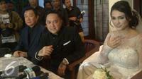 Feby Febiola dan Franky Sihombing akhirnya resmi menjadi suami istri. [Foto: Rizky Aditya Saputra/Liputan6.com]