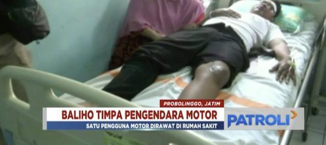 Seorang pengendara motor terluka parah usai tertimpa baliho caleg Probolinggo yang robek.