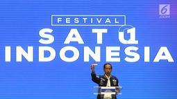 Calon Presiden petahana Joko Widodo saat memberikan pidato politiknya pada acara Festival Satu Indonesia di Istora Senayan, Jakarta, Minggu (10/3). Pada pidatonya Jokowi mengenalkan kartu prakerja bila terpilih. (Liputan6.com/Johan Tallo)