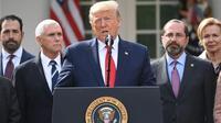 Konferensi pers oleh Presiden AS Donald Trump terkait Virus Corona yang kasusnya terus meningkat di Amerika Serikat. (Saul Loeb/AFP)