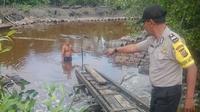 Dua korban penyerangan buaya di sungai dan lokasi korban diserang buaya. Foto: (M Syukur/Liputan6.com)