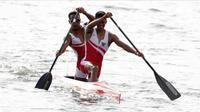 Pasangan Indonesia, Anwar Tara dan Yuda Firmansyah, saat beraksi pada SEA Games 2019 cabang kano nomor 1000 meter putra di Subic, Filipina, Jumat (6/12/2019). Pasangan Indonesia berhasil meraih medali emas. (Bola.com/M iqbal Ichsan)