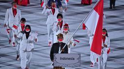 Tampak Rio Waida akan mengenakan baju adat Bali Payas Madya, yakni kemeja putih dan beskap hitam serta kain batik Bali gemerlap emas. (Foto: AFP/Ben Stansall)