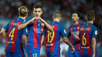 Ekspresi striker Barcelona, Munir El Haddadi, setelah mencetak gol kedua ke gawang Sevilla pada laga leg pertama Piala Super Spanyol 2016 di Ramon Sanchez Pizjuan, Sevilla, Senin (15/8/2016) dini hari WIB. (AFP/Jorge Guerrero)