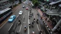 Mulai Desember, Pemprov DKI  berencana akan memberlakukan pembatasan kendaraan roda dua di sepanjang Jalan Medan Merdeka Barat hingga Bundaran HI, Jakarta, Selasa (11/11/2014). (Liputan6.com/Faizal Fanani)