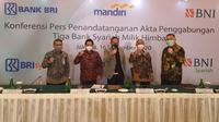 Konferensi Pers Penandatanganan Akta Penggabungan Tiga Bank Syariah Milik Himbara, Jakarta, Rabu (16/12/2020).