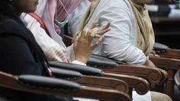 Saksi fakta Beti Kristiana memberi kesaksian dalam sidang sengketa Pilpres 2019 di MK, Jakarta, Rabu (19/6/2019). Beti memberi kesaksian terkait sengketa Pilpres 2019 untuk wilayah Jawa Tengah. (merdeka.com/Iqbal Nugroho)