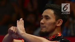 Atlet Wushu Indonesia Hulaefi Achmad saat berlaga pada final Men's Daoshu dan Gunshu Asian Games 2018 di JIexpo,Hall B, Jakarta, Selasa (21/8). Ini medali ketiga yang dipersembahkan tim wushu dalam Asian Games 2018. (Merdeka.com/Imam Buhori)