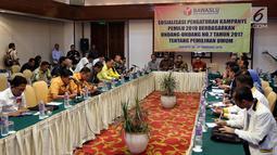 Suasana sosialisasi pengaturan kampanye pemilu 2019 berdasarkan undang undang no 7 tahun 2017 tentang pemilihan umum di Jakarta, Senin (26/2). (Liputan6.com/JohanTallo)
