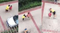 Dua orang pria yang diketahui memiliki beladiri Muay Thai dan instruktur MMA sekaligus jawara Tarung Bebas berkelahi berkelahi gara-gara parkir. (Shanghaiist)