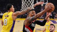Aksi Damian Lillard saat Blazers melawan Lakers (AP)