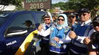 Direktur Utama PT Jasa Marga (Persero) Tbk Desi Arryani mengukuhkan Tim Satuan Tugas (Satgas) Jasa Marga Siaga Operasional Hari Raya Natal 2018 dan Libur Tahun Baru 2019 (Foto: Dok PT Jasa Marga Tbk)