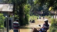 Ilustrasi - Banjir dan genangan bisa memicu penularan Leptospirosis. (Foto: Liputan6.com/Muhamad Ridlo)