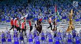 Kontingen Palestina melintas saat pembukaan Asian Games 2018 di Stadion Utama Gelora Bung Karno (SUGBK), Jakarta, Sabtu (18/8). Asian Games 2018 diikuti 45 negara. (Merdeka.com/Imam Buhori)