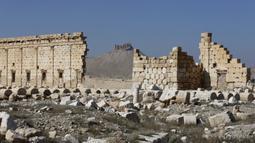 Sebagian pemandangan Kuil Bel yang rusak di kota kuno Palmyra, Provinsi Homs, Suriah, 7 Februari 2021. Suriah memiliki enam situs yang terdaftar dalam daftar elite warisan dunia UNESCO dan semuanya mengalami kerusakan dalam perang 10 tahun. (LOUAI BESHARA/AFP)