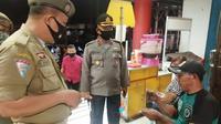 Polsek Matuari Polres Bitung berkolaborasi dengan Pemerintah Kota Bitung melakukan penertiban penggunaan masker terhadap warga.