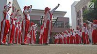 Sejumlah calon anggota Pasukan Pengibar Bendera (Paskibra) Nasional 2019 meneriakkan yel usai mengikuti latihan di PPPON Cibubur, Jakarta, Selasa (30/7/2019). Saat ini, 68 orang anggota Paskibraka nasional 2019 sedang menjalani pendidikan dan pelatihan intensif. (Liputan6.com/Herman Zakharia)