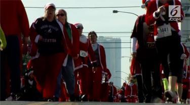 Di Las Vegas, AS digelar Santa Run. Sebuah lomba lari yang digelar untuk menyambut hari Natal.