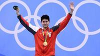 Josep Schooling menjadi peraih medali emas pertama Singapura sepanjang sejarah Olimpiade. (AFP/Gabriel Bouys)
