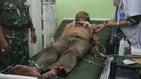 Mustafa saat dirawat di RS akibat keliru minum tinta Pilkada karena mata mengantuk dan dikira kopi. (foto : Liputan6.com / Raden AMP)