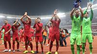 Pemain Timnas Indonesia merayakan kemenangan usai melawan Timor Leste pada penyisihan grup B Piala AFF 2018 di Stadion GBK, Jakarta, Selasa (13/11). Indonesia unggul 3-1. (Liputan6.com/Helmi Fithriansyah)