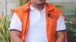 Staf Kemenpora Eko Triyanto tiba di Gedung KPK, Jakarta, Rabu (23/1). Diduga, ada kesepakatan antara pihak Kemenpora dan KONI untuk mengalokasikan fee 19,13 persen dari dana hibah Rp 17,9 miliar, yaitu sejumlah Rp 3,4 miliar. (Merdeka.com/Dwi Narwoko)