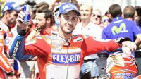 Pebalap Ducati, Andrea Dovizioso, enggan sesumbar terkait peluang menjadi juara dunia MotoGP 2017 meski baru saja memenangi balapan MotoGP Italia di Sirkuit Mugello, Minggu (4/6/2017). (Motorsport)
